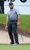 22.05.2015. Wentworth, England. BMW PGA Golf Championship. Round 2. Francesco Molinari [ITA] comes close with a putt on the 18th Green.