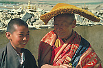 Shigatse, Tibet, a monk and a novice at Tashilhunpo Monastery