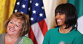 First lady Michelle Obama (R) and Fionnuala Kenny, wife of Prime Minister Enda Kenny of Ireland, smile during a reception in the East Room on March 19, 2013 in Washington, DC.<br /> Credit: Olivier Douliery / Pool via CNP