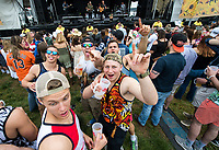 BALTIMORE, MD - MAY 20: Fans react to the camera while listening to a band perform in the infield on Preakness Stakes Day at Pimlico Race Course on May 20, 2017 in Baltimore, Maryland.(Photo by Scott Serio/Eclipse Sportswire/Getty Images)