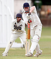 Jack Atchinson bats for North London during the Middlesex County Cricket League game between Highgate and North London at Park Road, Crouch End on Sat July 31, 2010.