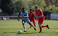Adam Thomas of Flackwell Heath & Tyreece Briscoe of Tuffley Rovers during the UHLSport Hellenic Premier League match between Flackwell Heath v Tuffley Rovers at Wilks Park, Flackwell Heath, England on 20 April 2019. Photo by Andy Rowland.