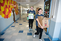 Alice Feng '20 and Alexandra Pfleegor '20 (glasses) on their way to present.<br /> Occidental students give presentations on STEM (science, technology, engineering, and mathematics) to students at Buchanan Street Elementary School in the Highland Park area of Los Angeles, Calif., March 8, 2018.<br /> In 30-minute presentations to kindergarten to sixth-grade students, Boundless Brilliance's teams of college students, all women currently attending Occidental, go into classrooms to create excitement about science. Through simple experiments (such as building a bridge between two chairs using only newspapers and tape) and a message couched in confidence, respect, and teamwork, their message to everyone—and young girls in particular—is simple: You are brilliant and you can be a scientist if you want to be.<br /> (Photo by Marc Campos, Occidental College Photographer)