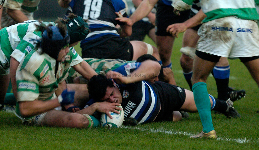 Photo: Richard Lane..Bath Rugby v Benetton Treviso. Heineken Cup. 11/12/2004..Duncan Bell touches down for a try.
