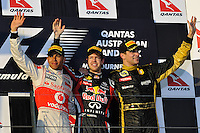 MELBOURNE, 27 MARCH - Sebastian Vettel (Germany) of the Red Bull Racing team, Lewis Hamilton (Great Britain) of the Vodafone McLaren Mercedes team and Vitaly Petrov (Russia) of the Lotus Renault GP team celebrate their success at the 2011 Formula One Australian Grand Prix at the Albert Park Circuit, Melbourne, Australia. (Photo Sydney Low / syd-low.com)