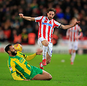 9th February 2019, bet365 Stadium, Stoke-on-Trent, England; EFL Championship football, Stoke City versus West Bromwich Albion; Joe Allen of Stoke City is tackled by Kyle Bartley of West Bromwich Albion