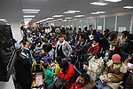March 17, 2011, Osaka, Japan - Foreign residents of Japan at the Osaka Regional Immigration Bureau are faced with long lines and at least a four hour wait for visa and re-entry permit renewal. (Photo by Daiju Kitamura/AFLO).