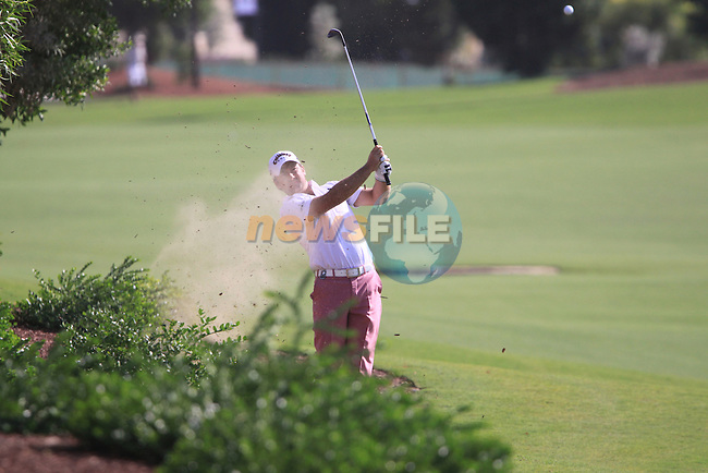 Greame McDowell plays his 3rd shot out of the rough on the 18th hole and puts it in the stream during the opening round of Day 1 at the Dubai World Championship Golf in Jumeirah, Earth Course, Golf Estates, Dubai  UAE, 19th November 2009 (Photo by Eoin Clarke/GOLFFILE)