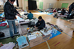 March 16, 2011, Sendai, Miyagi Prefecture, Japan - Victims of the 2011 Tohoku Earthquake and Tsunami try to settle in at an evacuation center set up in Sendai, Japan, to help in the aftermath of widespread damage from earthquakes, tsunamis, fires and potential exposure to radiation from the Fukushima Daiichi Nuclear Power Plant. (Photo by Tetsuro Chiharada/AFLO)