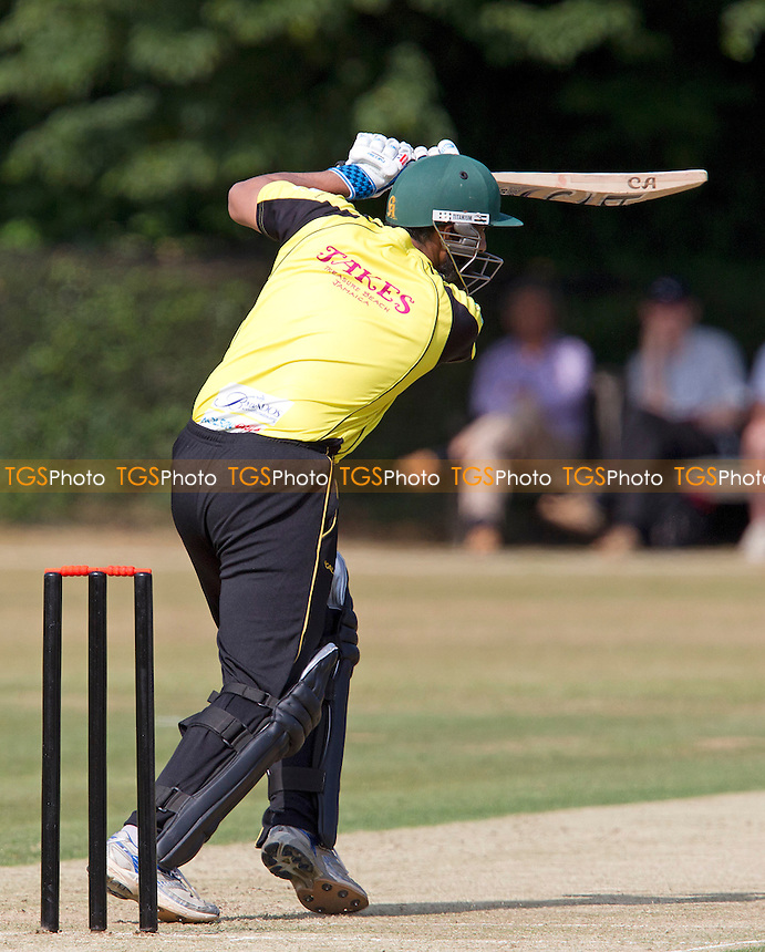 Mohammad Yousef, Lashings World XI drives through the covers  - Brentwood Buccaneers v Lashings World XI at the Old County Ground, Brentwood, Essex - 12/07/13 - MANDATORY CREDIT: Ray Lawrence/TGSPHOTO - Self billing applies where appropriate - 0845 094 6026 - contact@tgsphoto.co.uk - NO UNPAID USE