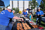 Members of the Kiwanis of Carson City cook breakfast at the Summer Reading Program Pancake Breakfast Kick-Off at the Carson City Library, in Carson City, Nev., on Saturday, June 8, 2013. <br /> Photo by Cathleen Allison
