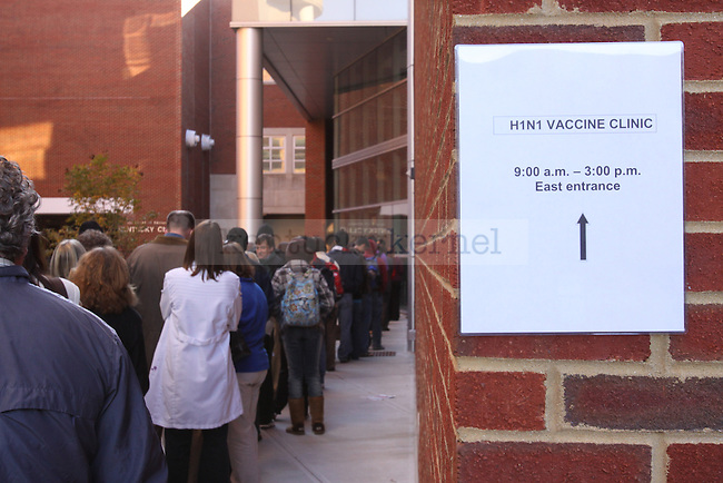 Lexington Residents and UK students wait in line on Thursday morning at the UK Health Clinic to receive the H1N1 vaccine. The vaccine became available for public use on Thursday.