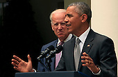 United States President Barack Obama with U.S. Vice President Joseph Biden by his side, delivers a statement on today's Affordable Care Act ruling from the U.S. Supreme Court in the Rose Garden of the White House on June 25, 2015.<br /> Credit: Dennis Brack / Pool via CNP