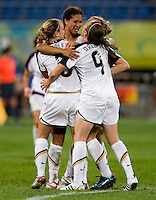 Lindsay Tarpley, Shannon Boxx, Heather O'Reilly. The USWNT defeated New Zealand, 4-0, during the 2008 Beijing Olympics in Shenyang, China.  With the win, the USWNT won group G and advanced to the semifinals.