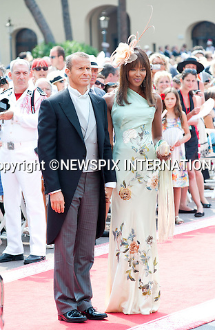"""MONACO ROYAL WEDDING.Naomi Campbell and Vladislav Doronin..Guests Arrive at the Religious wedding of H.S.H Prince Albert II and Miss Charlene Wittstock in the Prince's Palace._Prince's Palace Monaco 01/07/2011..Mandatory Photo Credit: ©Dias/Newspix International..**ALL FEES PAYABLE TO: """"NEWSPIX INTERNATIONAL""""**..PHOTO CREDIT MANDATORY!!: NEWSPIX INTERNATIONAL(Failure to credit will incur a surcharge of 100% of reproduction fees)..IMMEDIATE CONFIRMATION OF USAGE REQUIRED:.Newspix International, 31 Chinnery Hill, Bishop's Stortford, ENGLAND CM23 3PS.Tel:+441279 324672  ; Fax: +441279656877.Mobile:  0777568 1153.e-mail: info@newspixinternational.co.uk"""