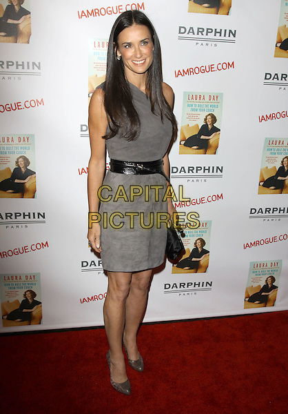 "DEMI MOORE .Laura Day's new book ""How to Rule the World from Your Couch"" Celebration held At STK Restaurant, Los Angeles, California, 19th October 2009..full length one shoulder grey gray  dress waist black belt shoes clutch bag .CAP/ADM/KB.©Kevan Brooks/AdMedia/Capital Pictures."