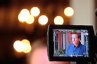 Jun. 16, 2009; Casa Grande, AZ, USA; Las Vegas head coach Jim Fassel is shown on a monitor as he speaks to the media during the groundbreaking of the Casa Grande Training Facility & Performance Institute in Casa Grande. Mandatory Credit: Mark J. Rebilas-