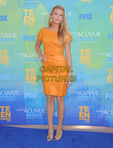 Blake Lively.The Fox 2011 Teen Choice Awards held at Gibson Ampitheatre in Universal City, California, USA..August 7th, 2010                           .full length dress hand on hip orange leather  .CAP/RKE/DVS.©DVS/RockinExposures/Capital Pictures.