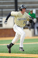 Garrett Kelly (28) of the Wake Forest Demon Deacons hustles down the first base line against the Marshall Thundering Herd at Wake Forest Baseball Park on February 17, 2014 in Winston-Salem, North Carolina.  The Demon Deacons defeated the Thundering Herd 4-3.  (Brian Westerholt/Four Seam Images)