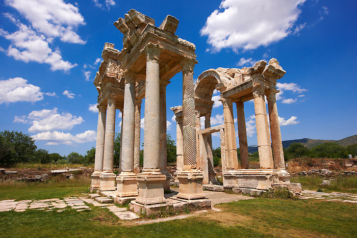 "Picture of the double Tetrapylon Gate 1, Aphrodisias, Turkey. A tetrapylon (Greek: Τετράπυλον, ""four gates"") is an ancient type of Roman monument of cubic shape, with a gate on each of the four sides: generally it was built on a crossroads. stock photos & photo art prints."