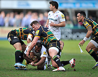 Northampton, England. Vereniki Goneva of Leicester Tigers tackled by Dylan Hartley (Captain) of Northampton Saints during the Northampton Saints and Leicester Tigers  during the Aviva Premiership match at Franklin's Gardens, Northampton, England on March 29, 2014
