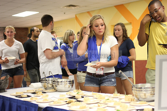 Students get free food at the Student Center Spectacular at the Student Center on Sunday, August 19, 2012. Student Center Spectacular encouraged new students to explore the Student Center and get involved at UK. Photo by Tessa Lighty | Staff