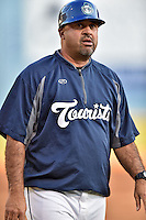 Asheville Tourists manager Fred Ocasio #28 during a game against the Lakewood BlueClaws at McCormick Field on May 3, 2014 in Asheville, North Carolina. The BlueClaws defeated the Tourists 7-4. (Tony Farlow/Four Seam Images)