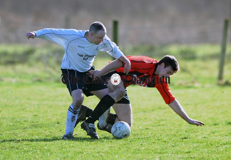 Ruan's Jonathon Clohessey holds off the challenge of Kieran Keane. Photograph by Declan Monaghan