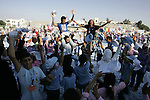 Palestinian children attend an event organised by the the United Nations Relief and Works Agency (UNRWA) in which they attempt to break the Guinness world record for the largest hand-print paint in Khan Yunis, southern Gaza Strip, on July 21, 2011. Photo by Abed Rahim Khatib