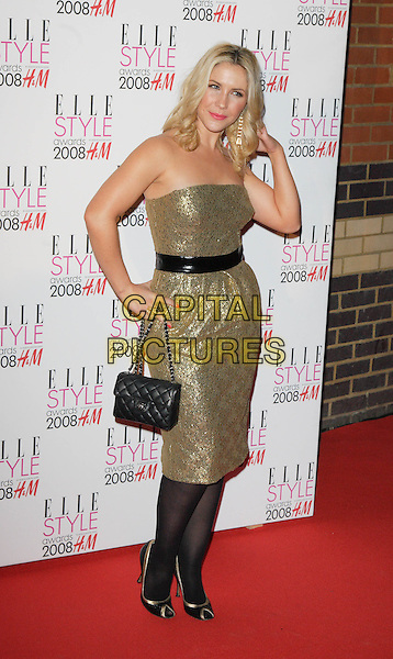 HEIDI RANGE.Red Carpet arrivals at the Elle Style Awards, held at the Westway, London, England. .February 12th, 2008.full length gold strapless dress hand on hip black tights bag purse shoes sugababes .CAP/ROS.©Steve Ross/Capital Pictures.