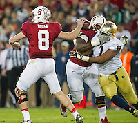 Defensive end Stephon Tuitt (7) tries to get pressure on Stanford Cardinal quarterback Kevin Hogan (8) in the second quarter.