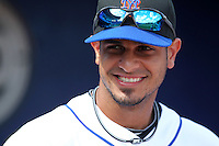 New York Mets Fernando Martinez #26 during an exhibition game vs the Michigan Wolverines at Digital Domain Ballpark in Port St. Lucie, Florida;  February 27, 2011.  New York defeated Michigan 7-1.  Photo By Mike Janes/Four Seam Images