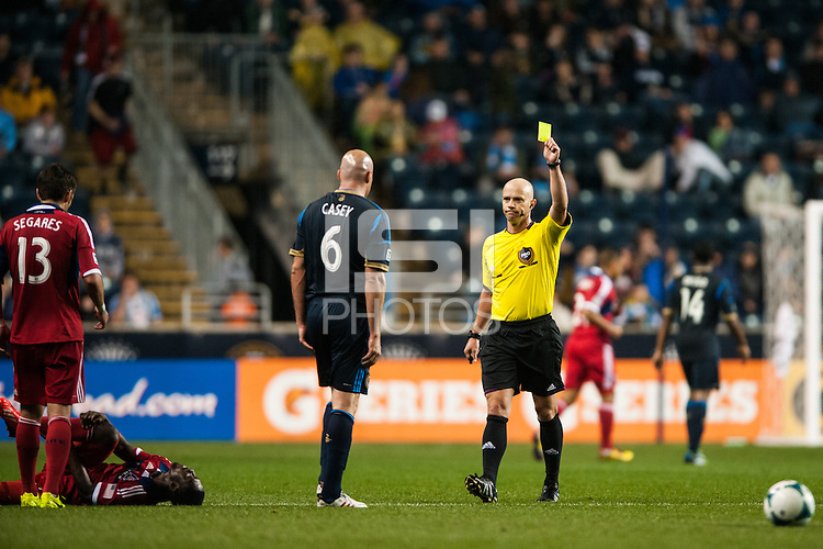 Referee David Ganter gives a yellow card to Conor Casey (6) of the Philadelphia Union. The Philadelphia Union defeated the Chicago Fire 1-0 during a Major League Soccer (MLS) match at PPL Park in Chester, PA, on May 18, 2013.