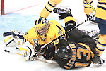 March 26,  2011                     Michigan goalie Shawn Hunwick (31) sprawls on the ice to block a shot in the third period as Colorado center Rylan Schwartz (13) falls in front of him. The University of Michigan defeated Colorado College 2-1 in the championship game of the NCAA Division 1 Men's West Regional Hockey Tournament, on Saturday March 26, 2011 at the Scottrade Center in downtown St. Louis.
