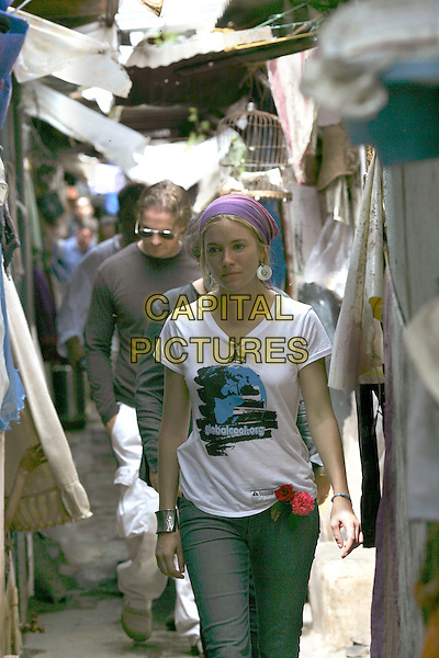 Picture by Andre Camara-07-.Global Cool in one of  Mumbai's slums, July 20, 2007. .Behind her walks Julian Knight, Global Cool's CEO.