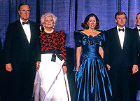 From left to right: United States President-elect George H.W. Bush, Barbara Bush, Marilyn Quayle, and US Vice President-elect Dan Quayle, attends the Inaugural Gala at the Washington DC Convention Center in Washington, DC on January 18 1989.   <br /> CAP/MPI/RS<br /> &copy;RS/MPI/Capital Pictures