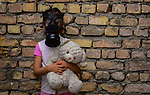 An Iraqi girl wears a mask holding a doll in her hand amid the novel coronavirus pandemic in Baghdad, Iraq, on April 9, 2020. Anas Jomaa