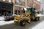 A Department of Transportation driver clears snow and ice from 1st Avenue after a snowstorm hit the Seattle area early Wednesday morning dumping at least 4 to six inches and will likely continue into the afternoon it a tough commute for drivers  in Seattle on January 18, 2012.  ©2012. Jim Bryant Photo. All Rights Reserved.