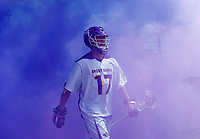 Jakob Patterson (#17) enters the stadium through the purple haze as UAlbany Lacrosse defeats Vermont 14-4  in the American East Conference Championship game at Casey Stadium, May 5.