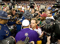 Alabama head coach Nick Saban shakes hands with LSU head coach Les Miles after winning the BCS National Championship game at Mercedes-Benz Superdome in New Orleans, Louisiana on January 9th, 2012.   Alabama defeated LSU, 21-0.
