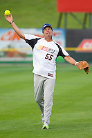 Michael Waltrip (55) of Team NASCAR warms up in the outfield prior to the game against Team NHRA in the NASCAR vs NHRA Charity Softball Challenge at CMC-Northeast Stadium on April 17, 2013 in Kannapolis, North Carolina.  Team NHRA defeated Team NASCAR 19-5.  (Brian Westerholt/Four Seam Images)