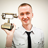 "WARSAW, POLAND, MAY 2011:.Michal Stankiewicz, call centre Consultant of the year 2009 is showing the ""golden phone"" statue that he received as an award..(Photo by Piotr Malecki / Napo Images)..WARSZAWA, MAJ 2011:.Michal Stankiewicz, telemarketer roku 2009 pokazuje nagrode zloty telefon, ktora otrzymal..Fot: Piotr Malecki / Napo Images"