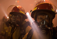 110226-N-DR144-562 ARABIAN SEA (Feb. 26, 2011) Airman Hunter Hollis and other Sailors on a hose team work in the smoke-filled hangar bay to combat a simulated class bravo fire during a general quarters drill aboard the Nimitz-class aircraft carrier USS Carl Vinson (CVN 70). The Carl Vinson Carrier Strike Group is deployed supporting maritime security operations and theater security cooperation efforts in the U.S. 5th Fleet area of responsibility. (U.S. Navy photo by Mass Communication Specialist 2nd Class James R. Evans / RELEASED)