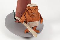 Origami caveman and tree. Caveman based on a devil designed by Jun Maekawa folded by Rosalind Joyce. Tree designed by John Montroll folded by Rosalind Joyce. Gingko leaves designed by Peter Engel folded by Delrosa Marshall.