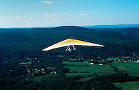 Hang glider soars over the Walker Valley, with Catskill mountains in the background. Walker Valley, New York.