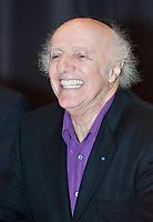 """Quebec singer Gilles Vigneault laughs in a press conference announcing government money for the Festival des musiques sacrÈes de QuÈbec (Quebec sacred music festival) where Vigneault will compose and produce """"La Grande-messe"""" (the Great Mass) with Bruno Fecteau."""