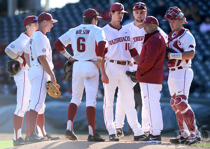 NWA Democrat-Gazette/ANDY SHUPE<br /> Arkansas pitching coach Wes Johnson speaks to his battery, Blaine Knight and catcher Grant Koch and the Arkansas infield against Bryant Friday, Feb. 24, 2017, during the third inning at Baum Stadium in Fayetteville. Visit nwadg.com/photos to see more photographs from the game.