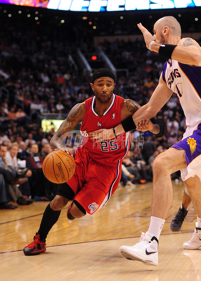 Mar. 2, 2012; Phoenix, AZ, USA; Los Angeles Clippers forward Mo Williams controls the ball during game against the Phoenix Suns at the US Airways Center. The Suns defeated the Clippers 81-78. Mandatory Credit: Mark J. Rebilas-USA TODAY Sports