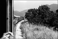 A train heading south to Greece. This passenger train from Budapest to Thessaloniki runs through the heart of former Yugoslavia. Southern Macedonia, June 1998 © Stephen Blake Farrington<br />