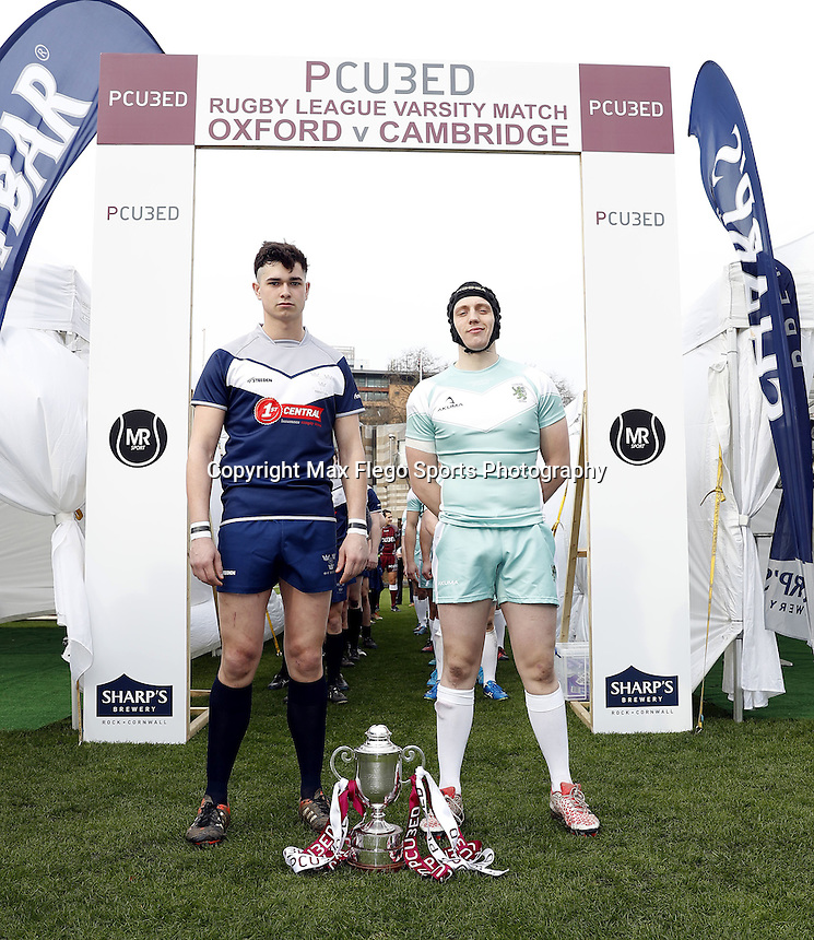 Oxford and Cambridge team captains pose for a photo prior to the Pcubed Rugby League Varsity game between Oxford and Cambridge University at the HAC Ground, London, on Fri March 3, 2017